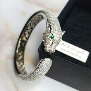 Sterling silver tiger bangle with emerald eyes